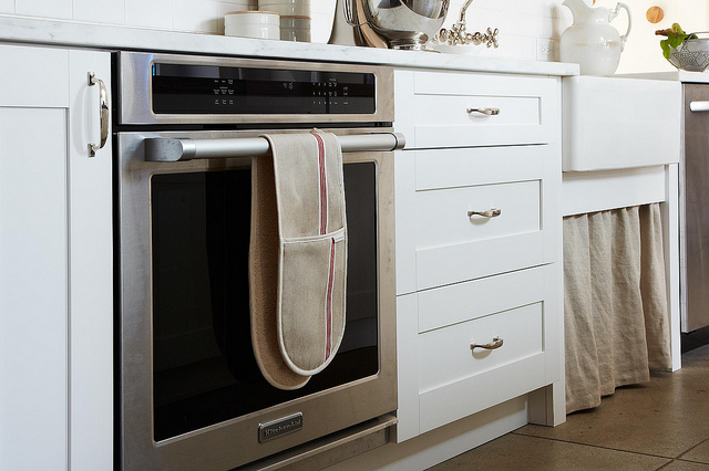 Popular food flog Food52 unveils new test kitchen featuring white cabinets by Diamond Cabinets.