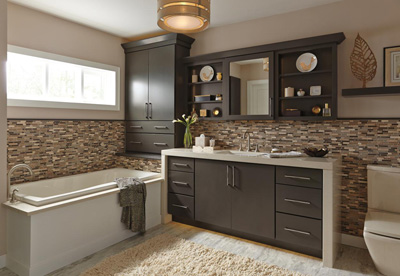Olive green bathroom cabinets by Kemper Cabinetry in the Forest Floor color