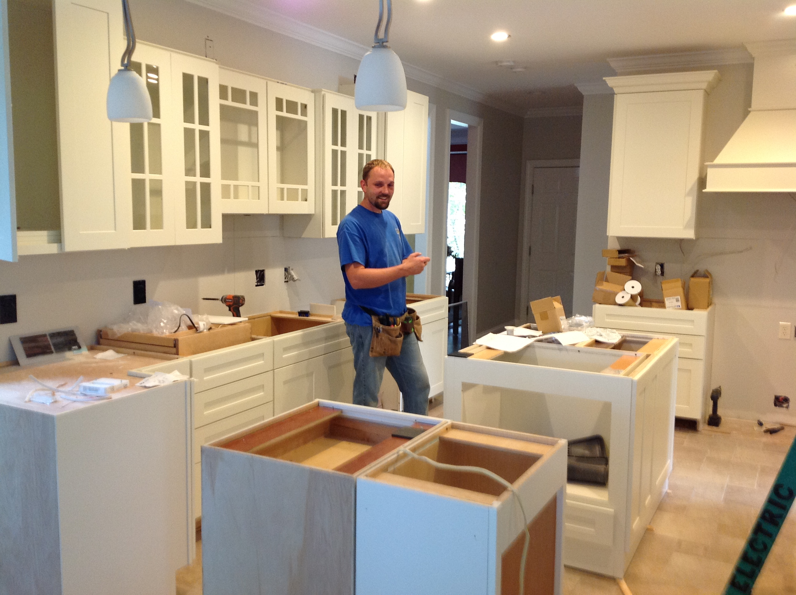 "Beautiful white cabinetry replaced the old, outdated cabinets and gave the kitchen remodel on ""For Your Home"" some character."