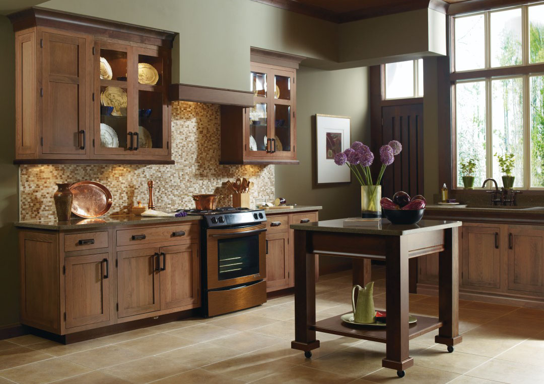 Rivington cabinet doors with wood-enhancing cabinetry finish highlight traditional, bright kitchen design