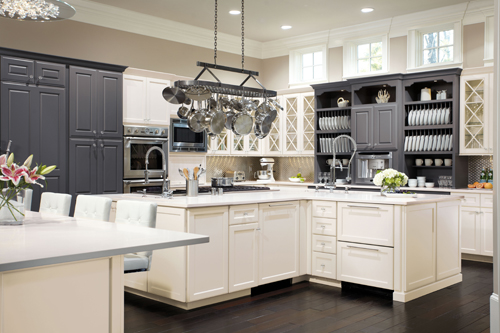Traditional kitchen space uses trend-forward style with Omega's Williamsburg cabinet door style in an Oyster opaque cabinet finish.