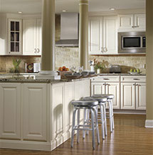 Renovated kitchen with island and off-white Aristokraft cabinets