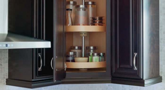 Rotating spice rack cabinet by Kemper Cabinetry