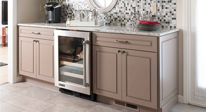 Neutral colored Anden cabinets surround the wine fridge