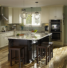 Renovated kitchen with neutral-colored Homecrest cabinets