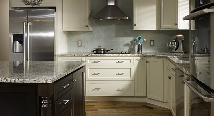 Kitchen remodel features ivory cabinets by Homecrest
