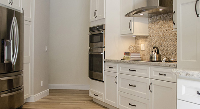 Remodeled kitchen with off white cabinets>