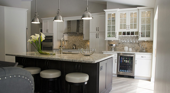 Remodeled Kitchen With Off White Cabinets And A Dark Maple Island