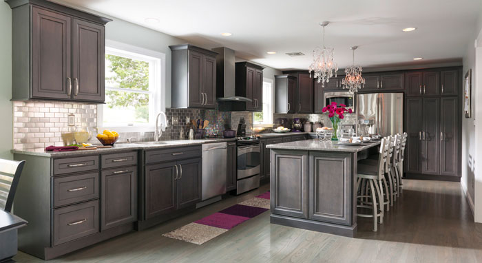 Remodeled kitchen featuring gray kitchen cabinets by Decora>