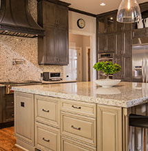 Renovated kitchen with Kitchen Craft cabinets granite counters and a kitchen island