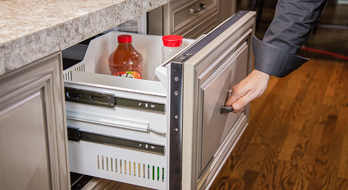Close-up of refrigerator drawer in kitchen island>