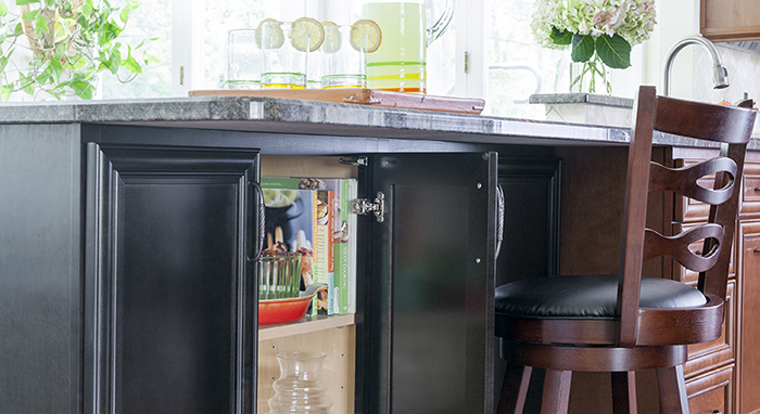 These black kitchen cabinets are perfect for storage.>