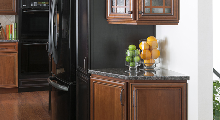 Granite counters complement the cherry and maple kitchen cabinets.>