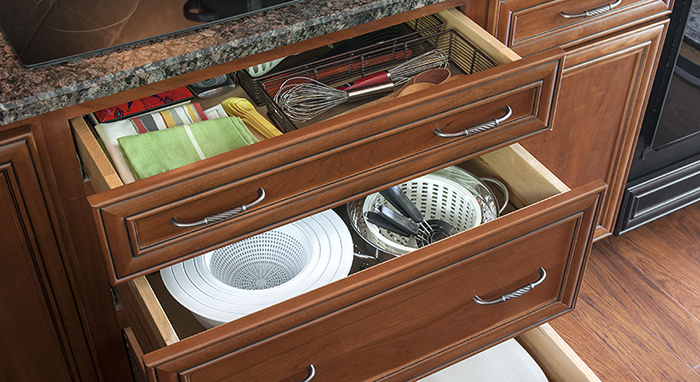 Cabinetry drawers offering storage and organization in the kitchen.>