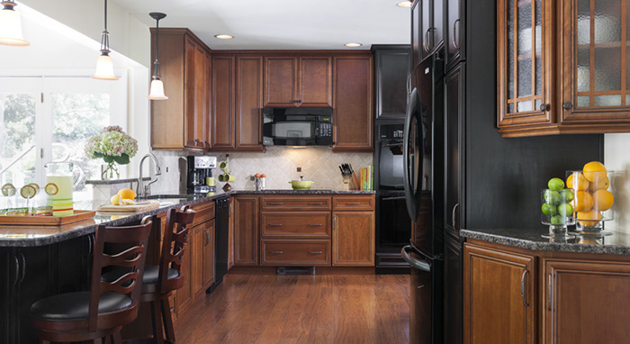 Dark cabinets help bring life to this modern kitchen design.>