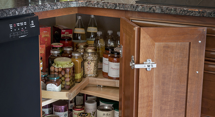 This corner cabinet makes the most of its available storage space.>