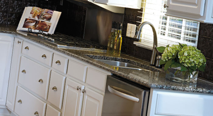 Close-up of Augusta White Thermofoil kitchen cabinets by Aristokraft