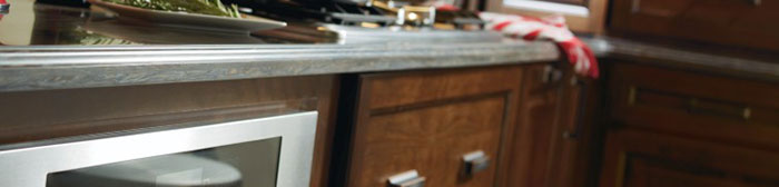 Countertop and cherry kitchen cabinet close-up