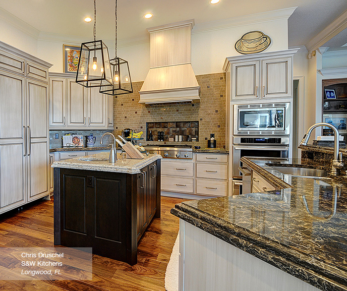 off white cabinets with a dark wood kitchen island masterbrand rh masterbrand com Painting Stained Cabinets White White Paint Stain