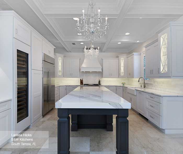 White Kitchen Cabinets with a Dark Grey Island