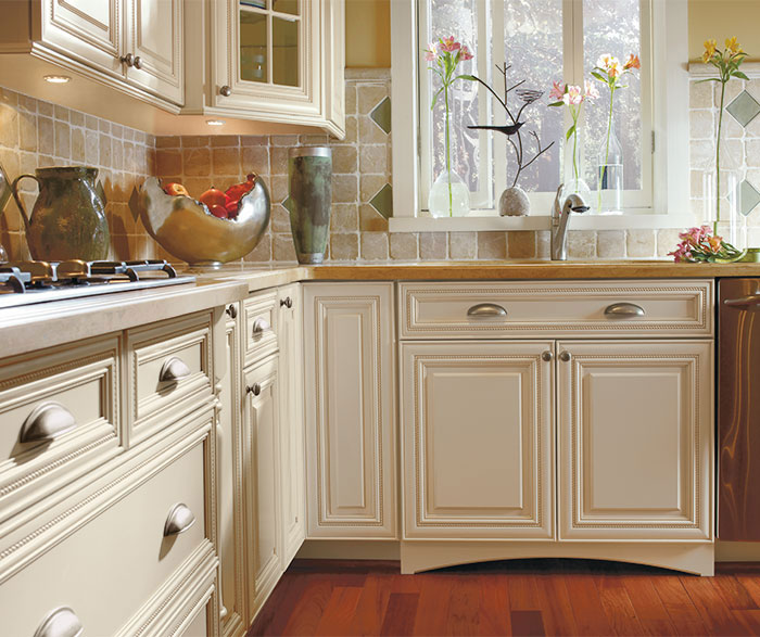 Will White Kitchen Cabinets Stay In Style: Off White Cabinets With Glaze In A Traditional Kitchen