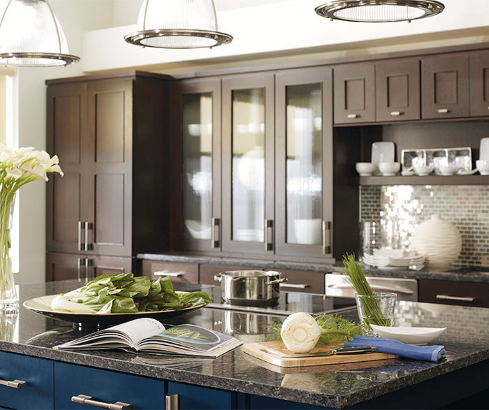 Dark Wood Cabinets with a Blue Kitchen Island