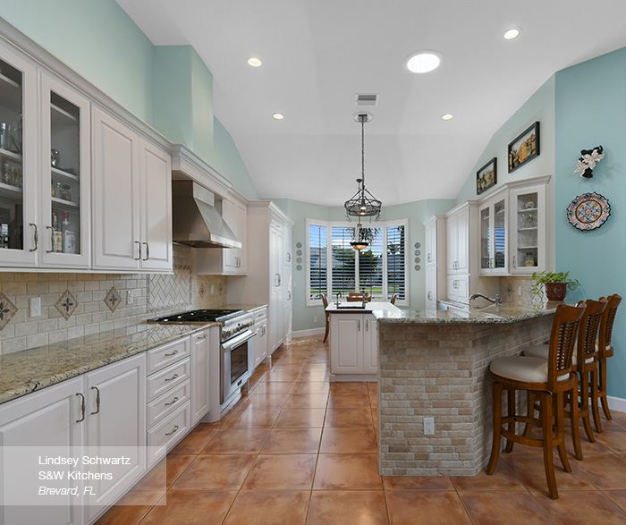 Off white cabinets with a blue kitchen island masterbrand for Casual home kitchen island