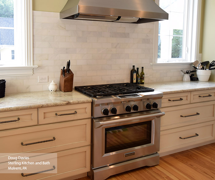 Off white glazed cabinets in a casual kitchen