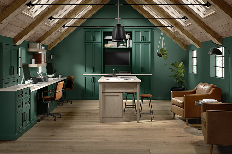 An ideal work from home space by Starmark - Edgemore cabinet style on Maple with Bottle Green cabinet finish and Edgemore cabinet style on Oak with Tarragon cabinet finish