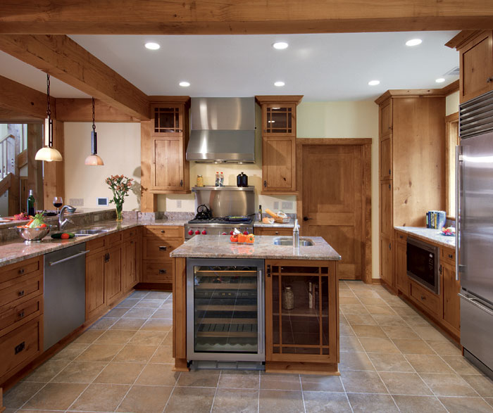 Knotty alder kitchen cabinets in natural finish by Kitchen Craft Cabinetry