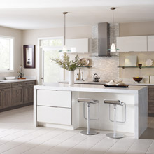 Diamond semi-custom kitchen cabinets in woodgrain and white high gloss laminate