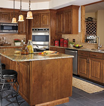 Renovated traditional-style kitchen with rustic birch cabinetry from Aristokraft