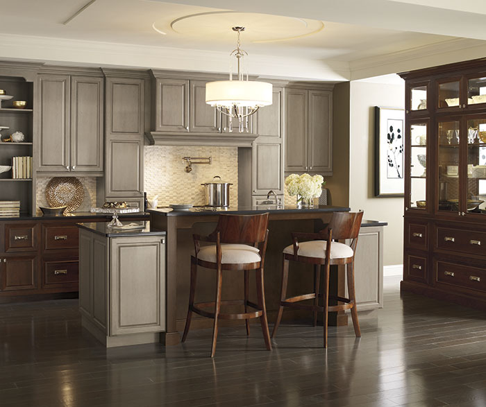 Traditional kitchen with Brookside and Riff Cherry cabinets in Pumice and Chestnut finishes